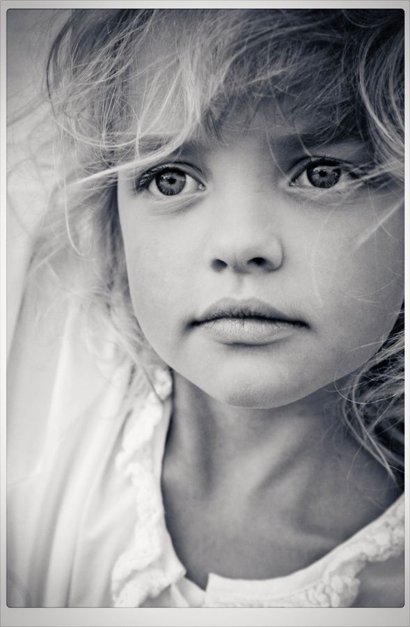 I have no idea why this picture moved me maybe it was the innocence serenity or just how the photographer captured this beautiful little girl