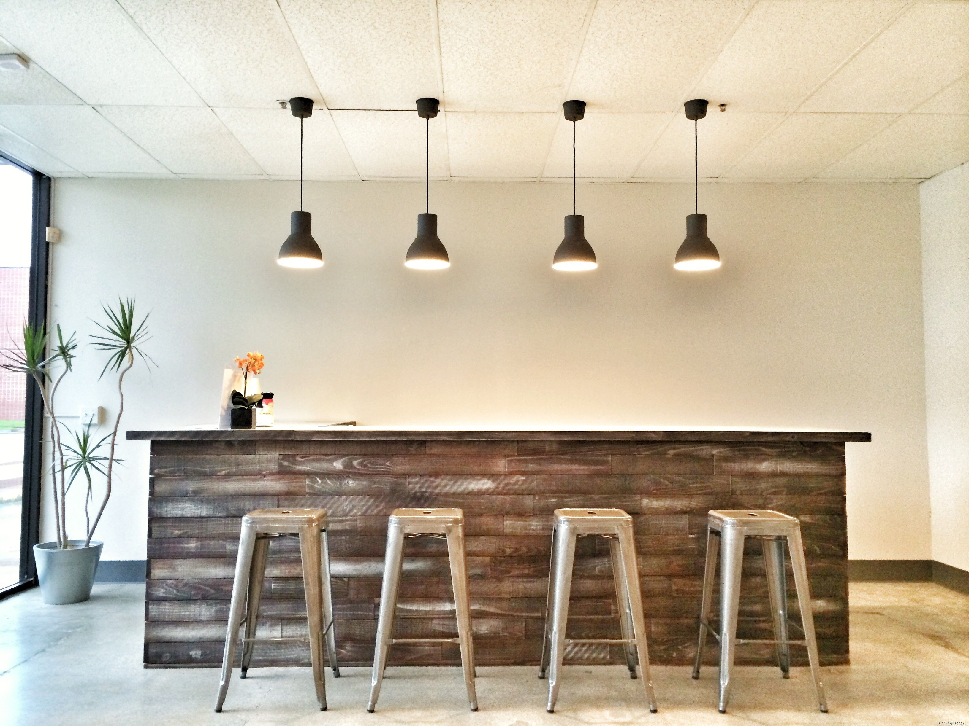 Rustic Weathered Wood Bar With Metal Barstools And 4 Pendants