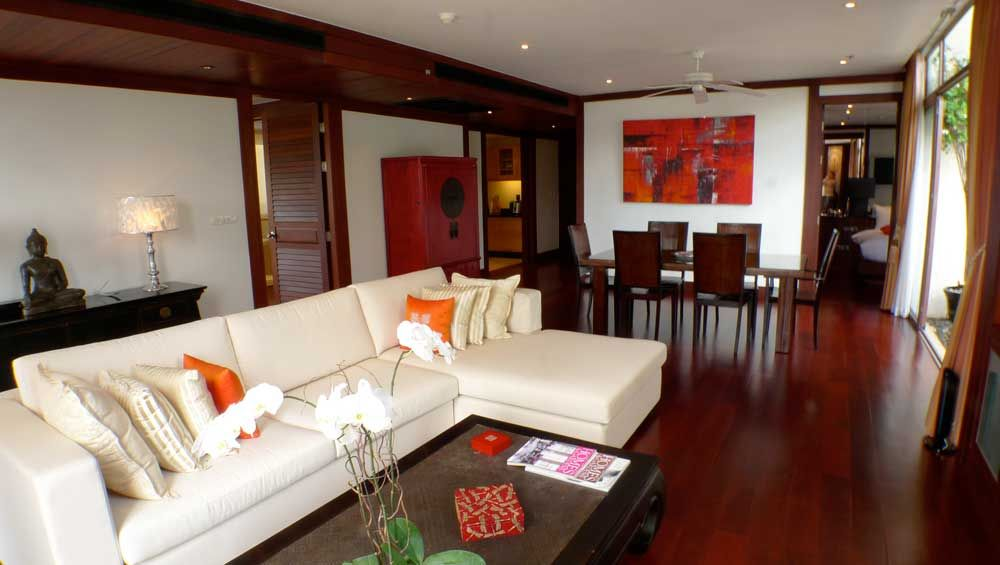 Cherry Wood Floors With White Couches