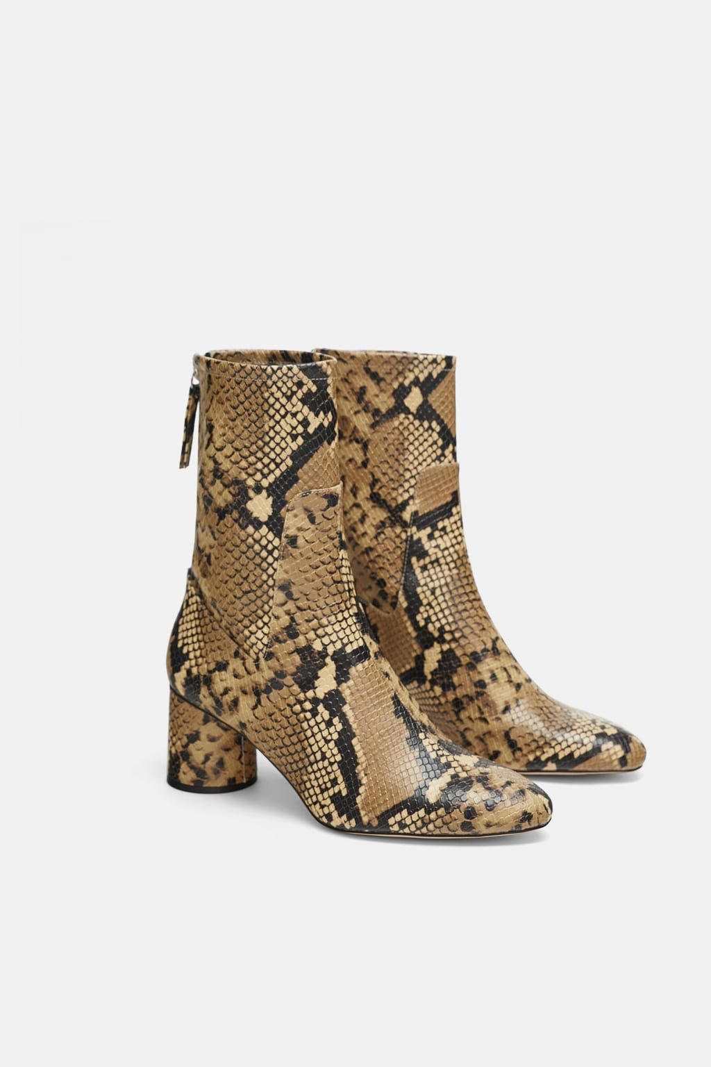 29189377d991 Image 4 of HEELED ANIMAL PRINT ANKLE BOOTS from Zara