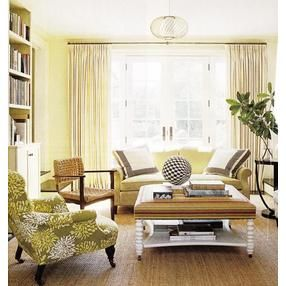 Creamy Yellow Walls And Sofa Cream Curtains Black White And Green Graphics On Sea Grass Rug Yellow Living Room Small Apartment Decorating Home Decor