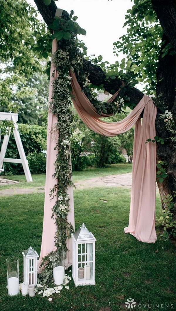 wedding ceremony arch decorated with greenery and dusty rose drapery wedding ceremony arch decorated with greenery and dusty rose drapery ,