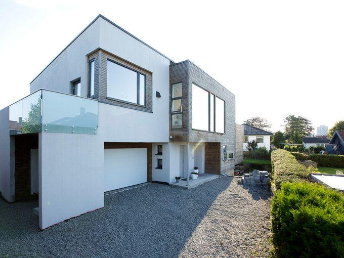 Et murhus som nesten i sin helhet er satt opp med leca for 70s house exterior makeover australia