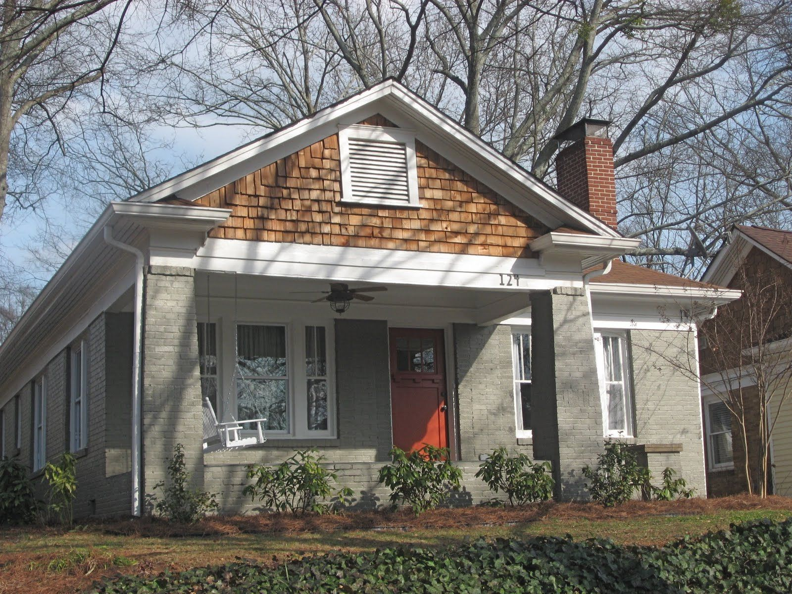 Warm gray with white trim and brown roof Like the orange door