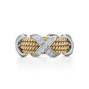 Anillo de cuatro hileras con X Schlumberger estilo soga, oro de 18k y diamantes.