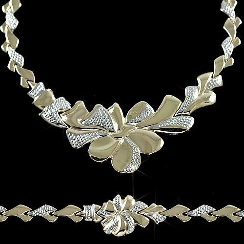 """This necklace and bracelet set is so very unique and dazzling! It is a Genuine 1/10th 10kt Yellow Gold and 9/10th's Sterling Silver Stampato Style Necklace Chain & 8"""" Bracelet Set . We can't think of a better way to express your love for that special someone!  $399.99 http://www.everythingbling.com"""