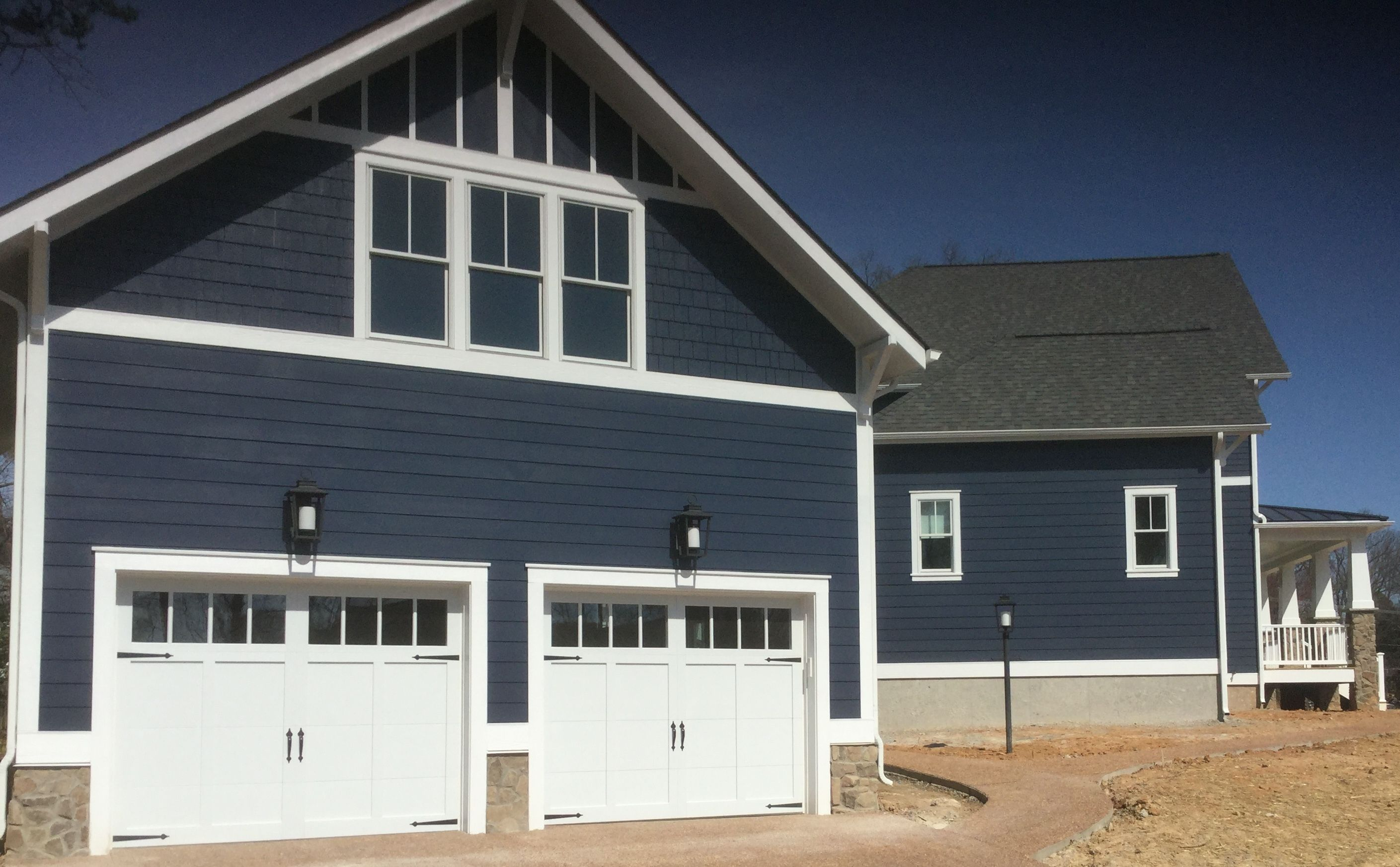 Two 9x7 Model 5630 Carriage style overlay garage doors with Square Madison top glass installed by the Richmond store.