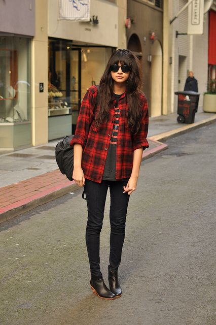 Grunge. Flannel shirt, oversized PJ top, black jeans and cowboy boots. :)