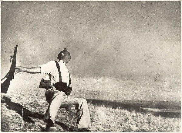 The Falling Soldier Robert Capa  (American (born Hungary), Budapest 1913–1954 Thai Binh) Date: 1936 Medium: Gelatin silver print Dimensions: Image: 24.7 x 34 cm (9 3/4 x 13 3/8 in.) Classification: Photographs Credit Line: Gilman Collection, Purchase, Alfred Stieglitz Society Gifts, 2005 Accession Number: 2005.100.166 Rights and Reproduction: Photograph by Robert Capa © Cornell Capa / Magnum