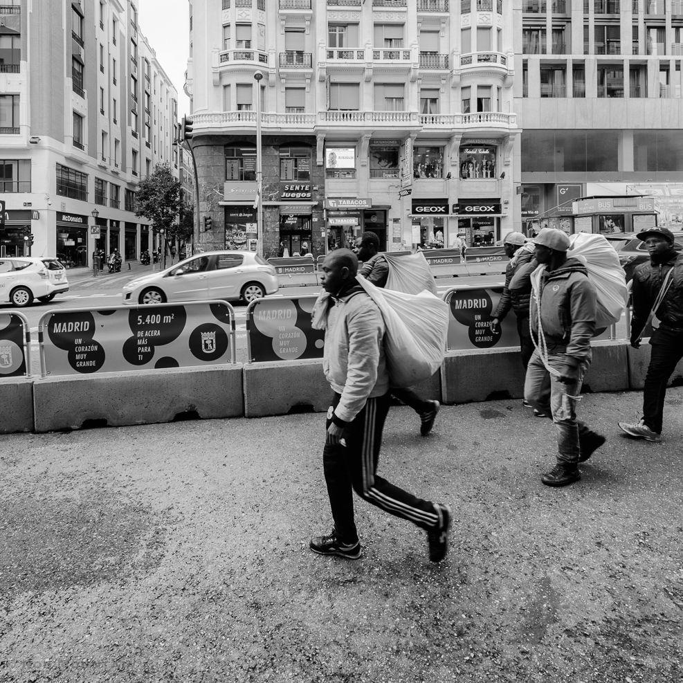 Madrid, Spain - Street vendors walking along Calle Gran Via during the afternoon in Madrid.   Image: © Rod Mountain  #storyofthestreets #timeless_streets #noirstreetlife #capturestreets #streetshared #imaginatones #streettogether #worldbestgram #blackandwhite #excellent_bnw #exploretocreate #featuremeinstagood #bnw_guru #bnw_madrid #enblancoynegro #bnw_city #bnw_society #instatraveling #sharetravelpics #socialdocumentary #traveldocumentary #ourplanetdaily #bwstylesgf #bnw_captures