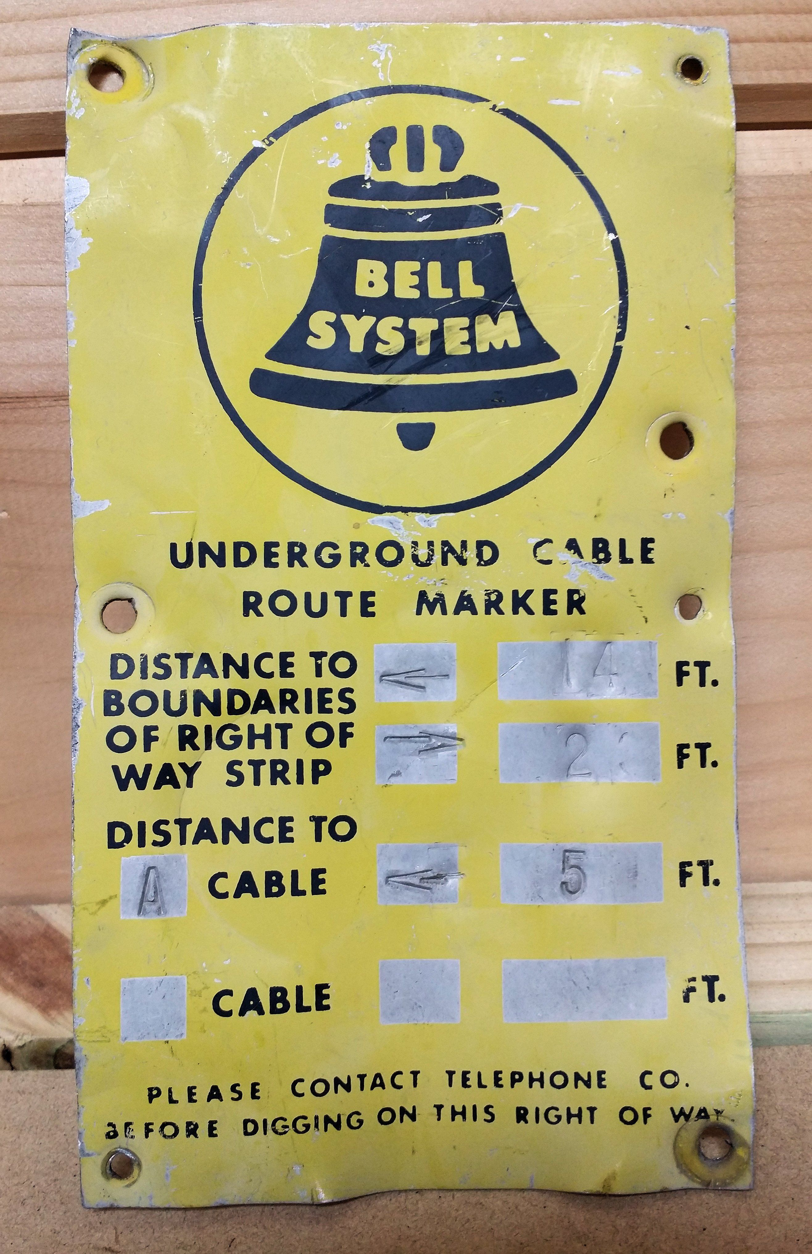 Bell System buried cable sign used to identify location of