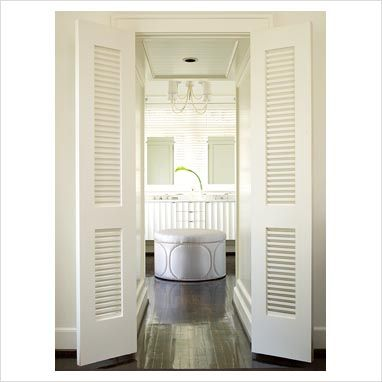 GAP Interiors Slatted doors to modern bathroom Picture library