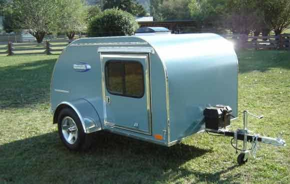 Maybe Get A Small Pull Behind Camper That Acts As The Bathroom Add Toilet And Shower Small Camping Trailer Teardrop Camper Teardrop Camper Trailer
