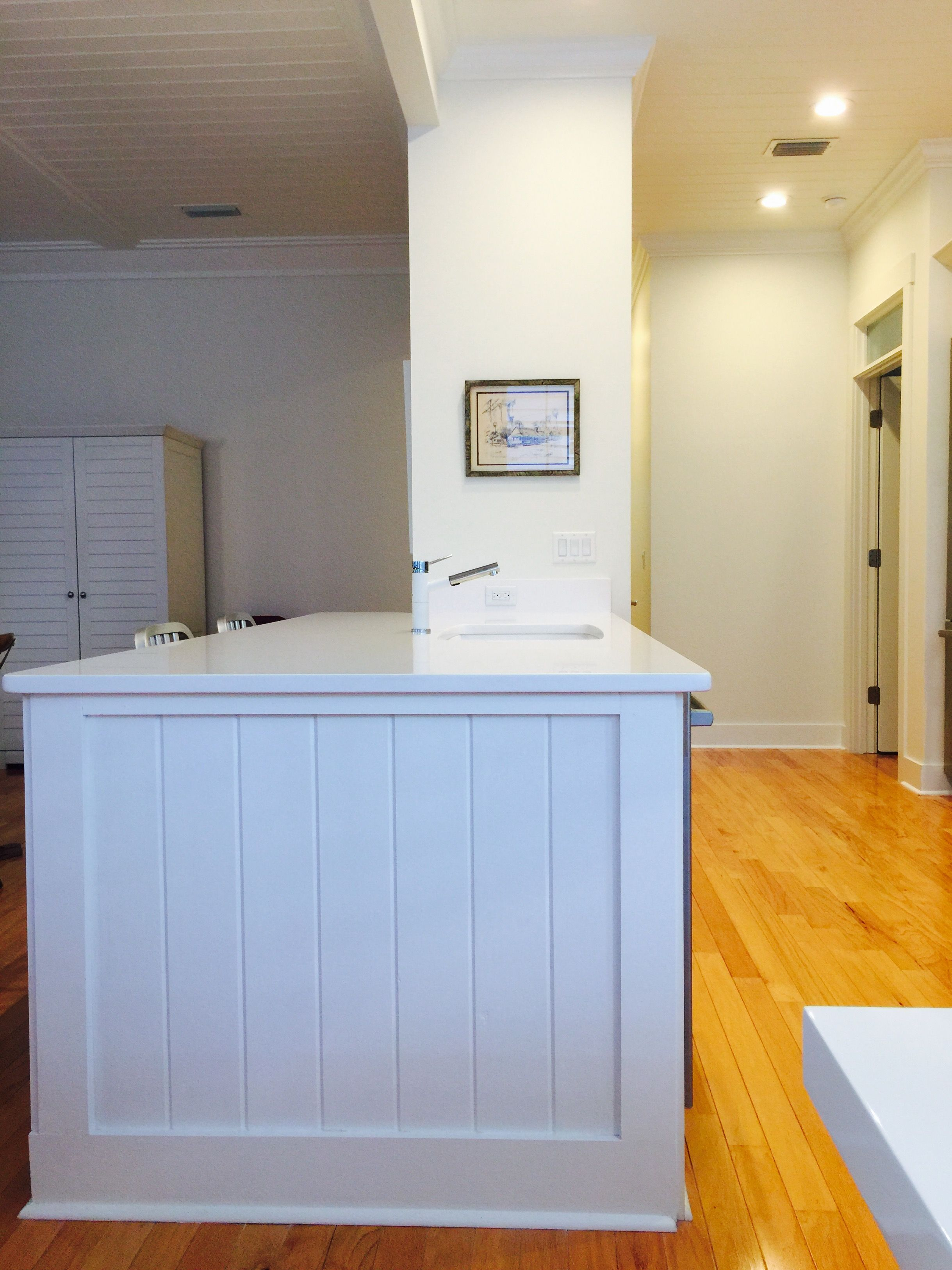 Peninsula with white granite sink and sketch of Cross Creek on wall ...