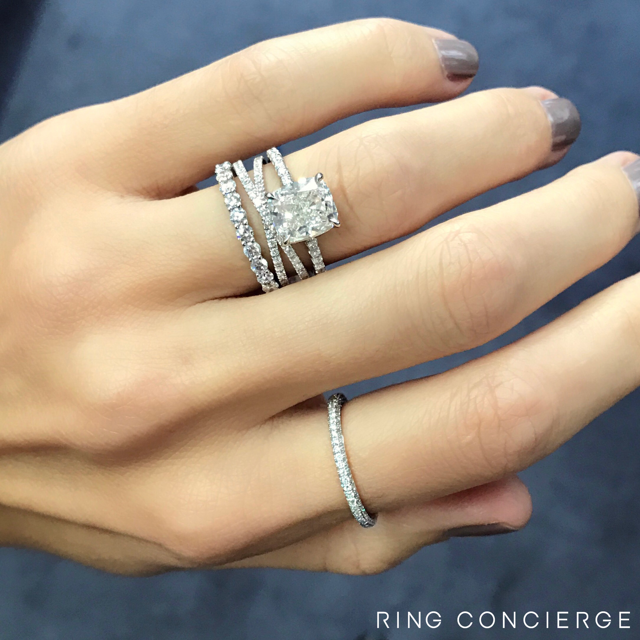 3ct Cushion Paired With A Crisscross Wedding Band And A Round