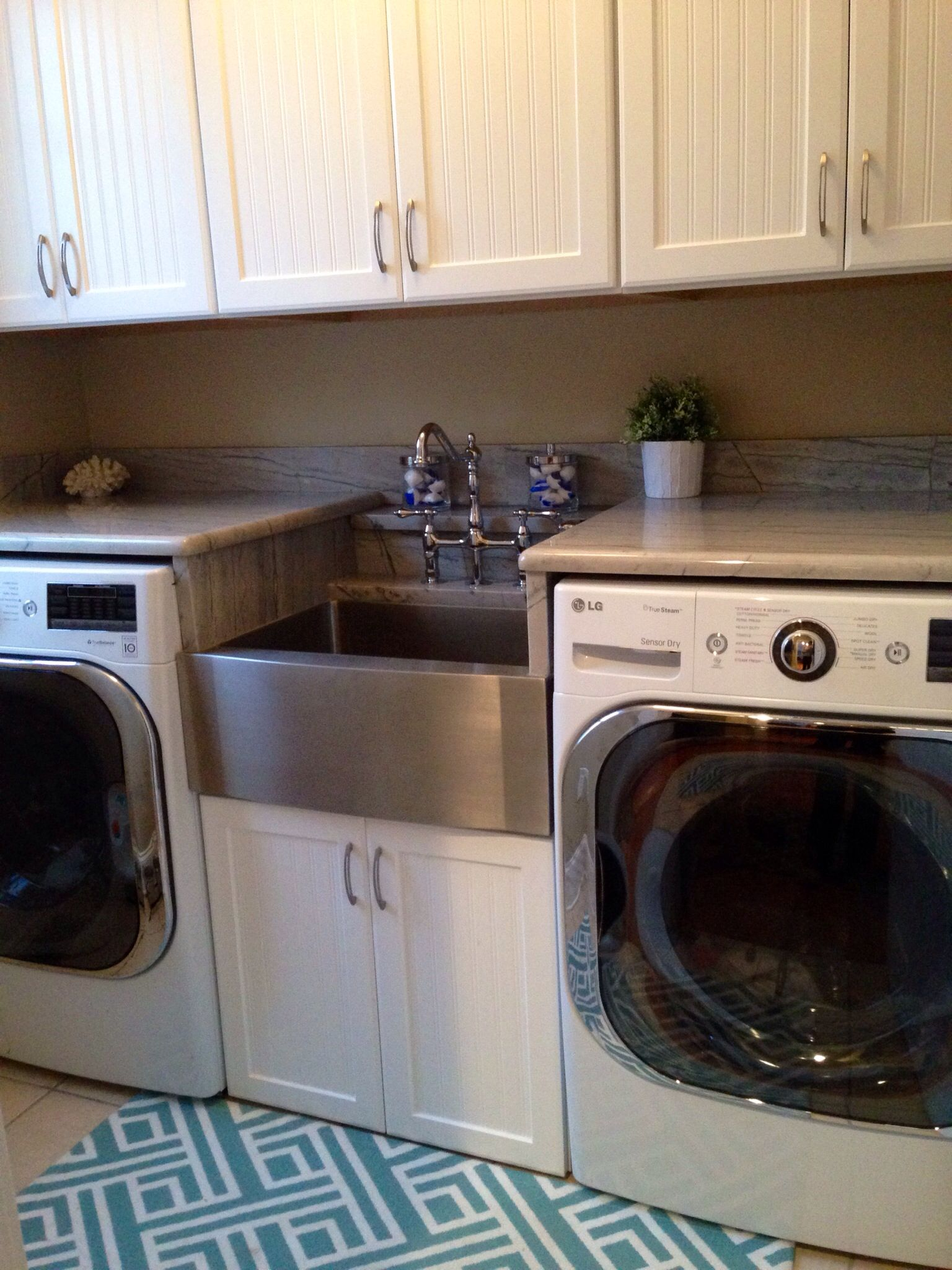 Gorgeous small laundry room white cabinets marble looking granite