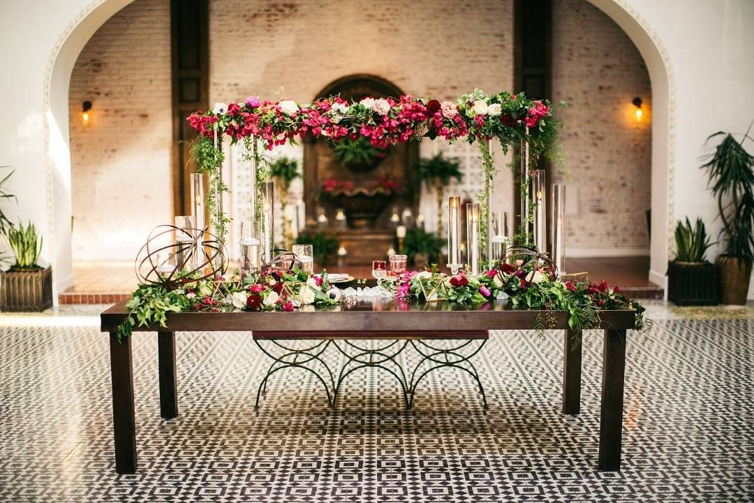 A lush display of floral details for this sweetheart table designed by @eventsbycassie. || Creative Partners - Venue:@ebelloflb | Design & Cordination: @eventsbycassie | Photography: @three16photography | Linens: @luxe_linen | Rentals: @sigpartyrentals @sundrop_vintage | Floral Design: @flowerallie