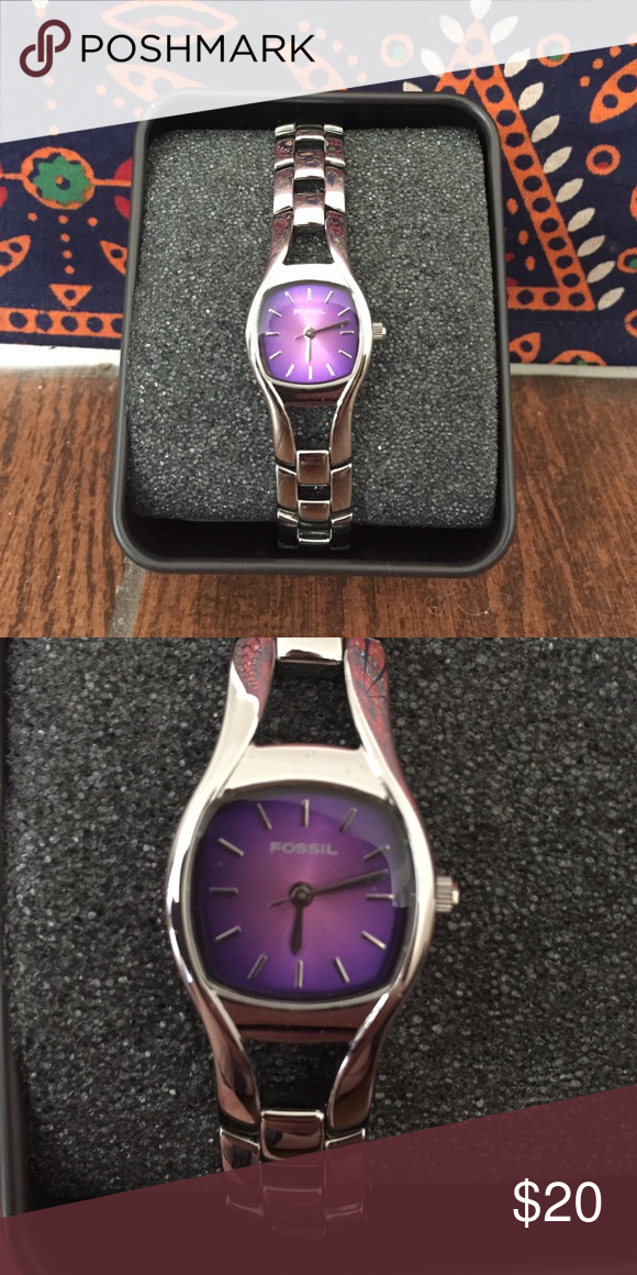 Fossil Watch Stainless steel Fossil watch with purple face. Never worn, like new in original box. Needs new battery. Fossil Accessories Watches