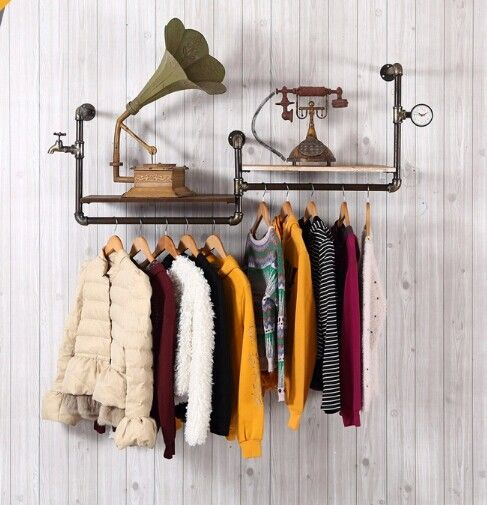 New clothing store shelves clothing display rack on the wall ...