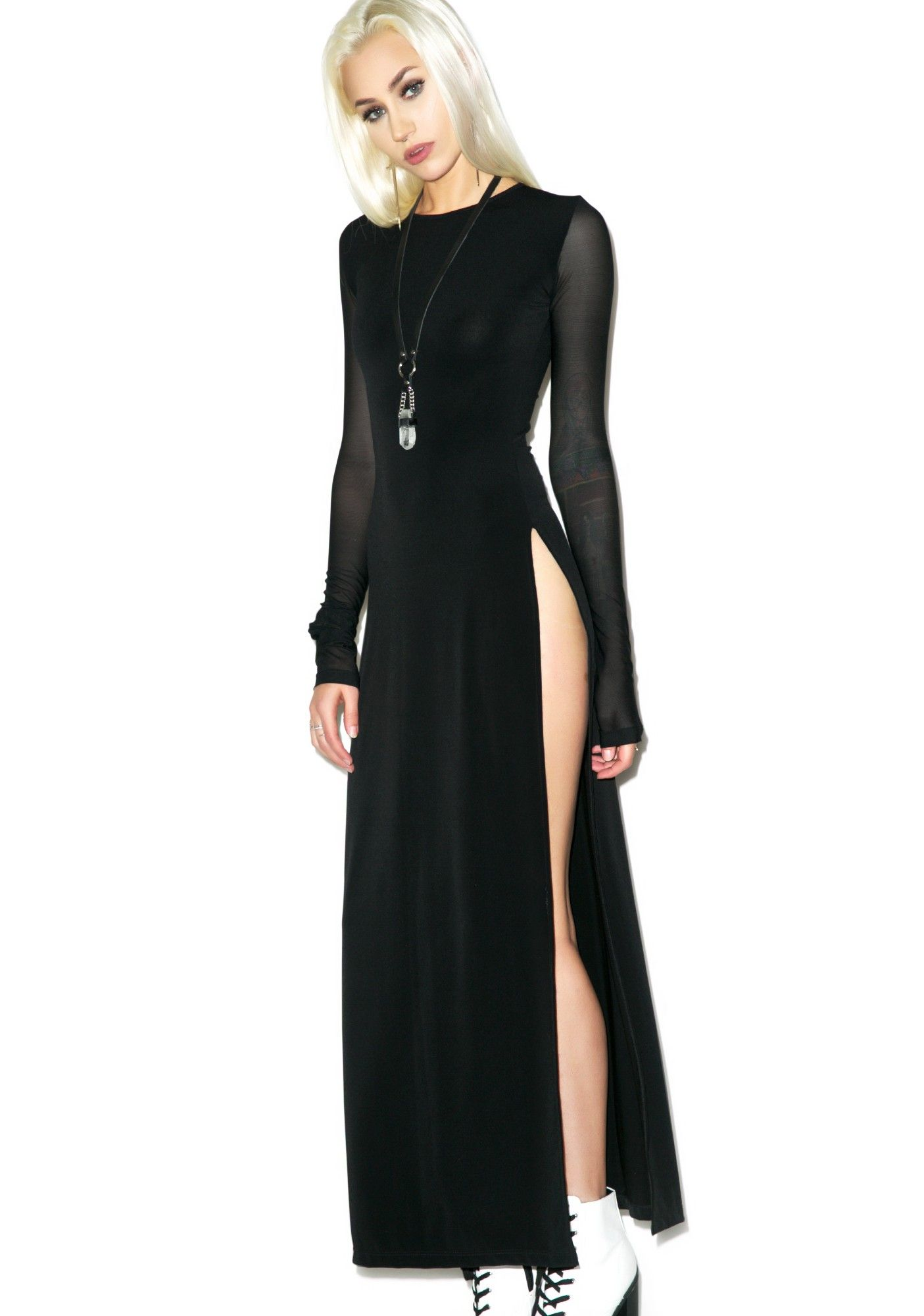 6405c26863d Features Black magic maxi dress Mesh long sleeves A keyhole back detail  Thigh-high slits on both sides with Black Wednesday Branding .