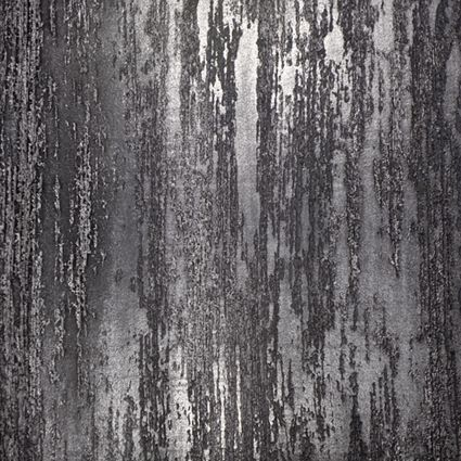 Textured plaster wall treatment in black plaster with silver metallic mica powder.