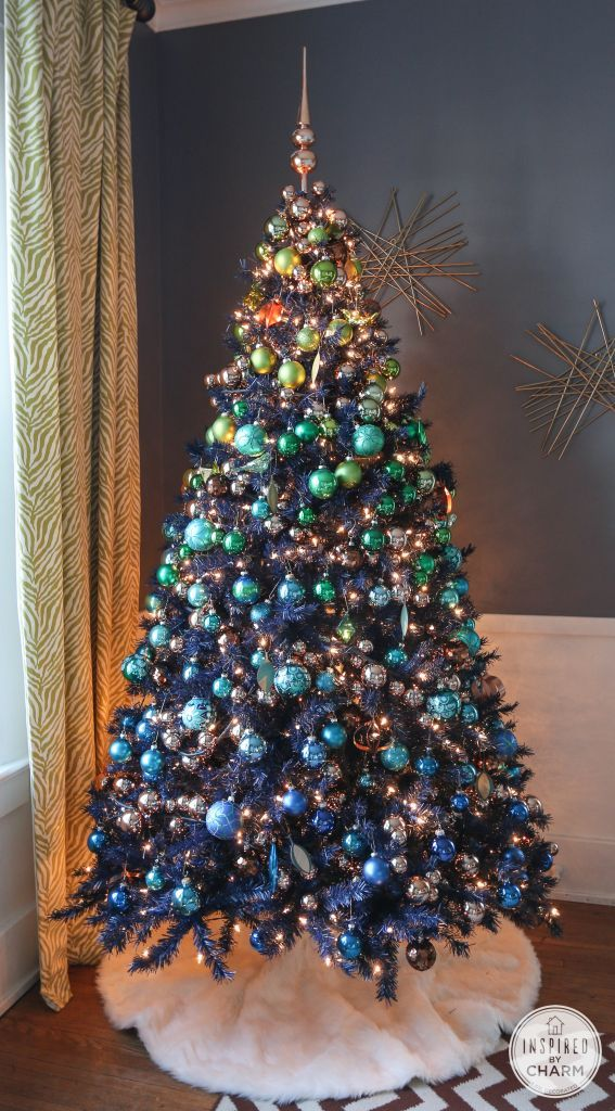 Navy Blue Christmas Tree Decorated With Greens Blues And Copper