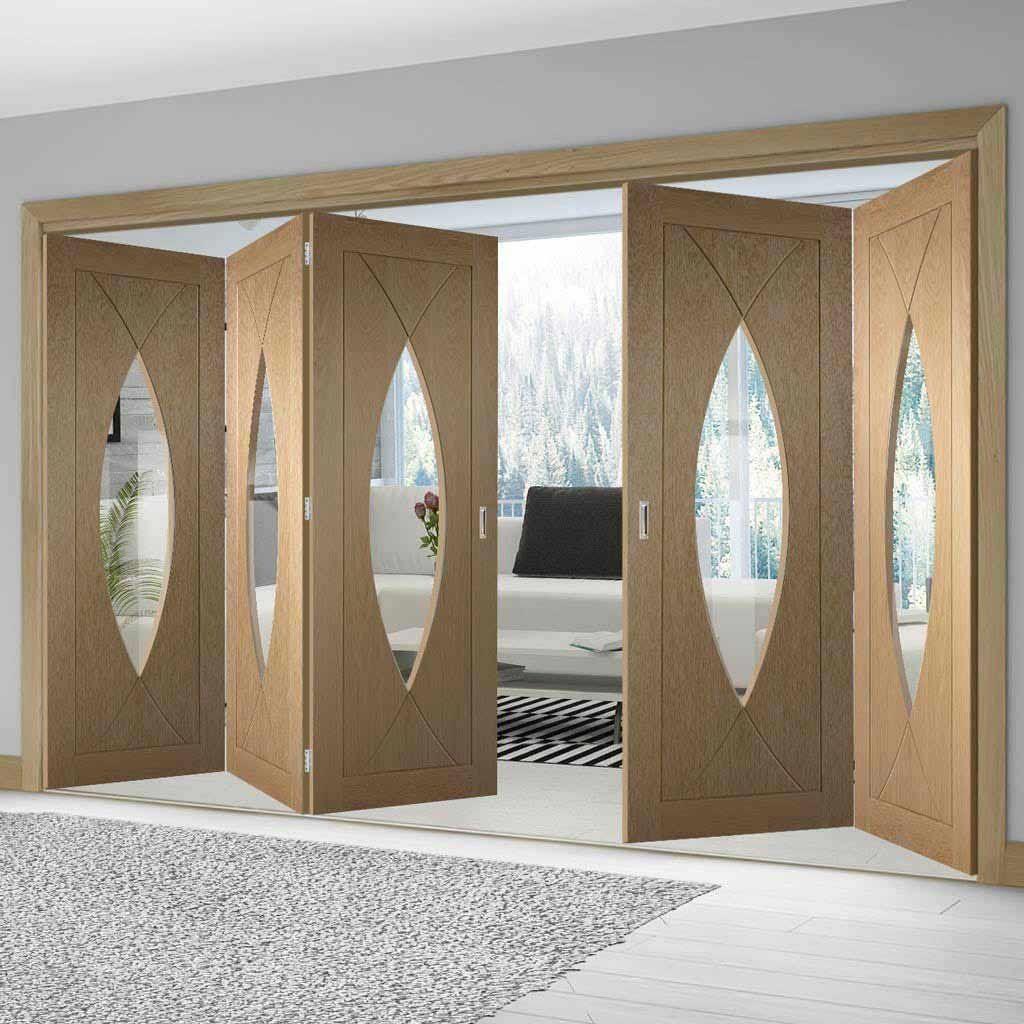 Thrufold Pesaro Oak 3+2 Folding Door - Clear Glass - Lifestyle Image.    #glazedfoldingdoors #foldingdoors