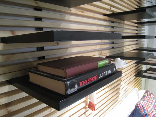 Wood slat wall with shelves. it's called a mandal shelf.