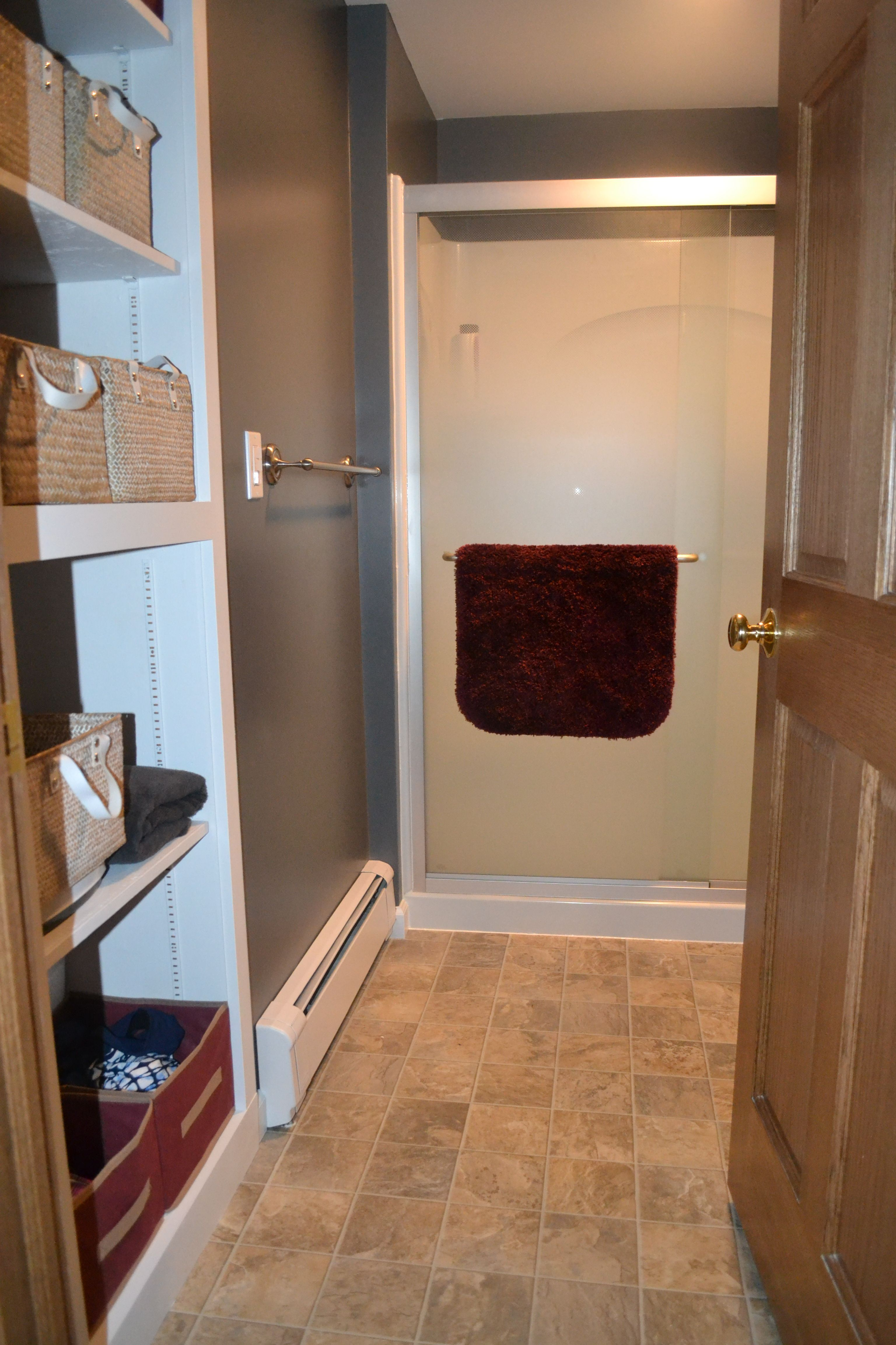 Small Bathroom remodel - bravely removed closet door. Baskets in ...