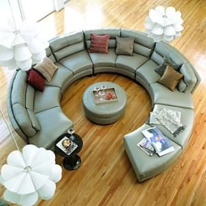 Conversation couch. Yeah, if we are ever uber rich, I will have one of these in a room just devoted to hanging out. No tv; just this couch, a snack bar,  great decor, & friends.