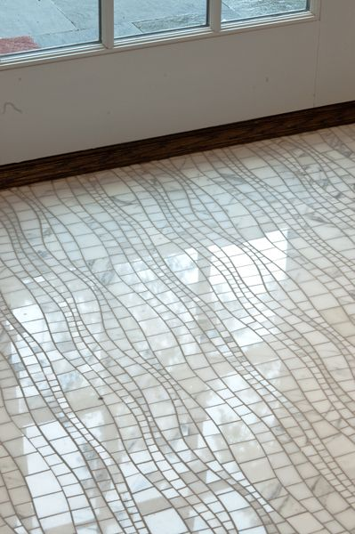 Artistic Tile |  Designed by Nancy Epstein Artistic Tile Founder & CEO |  Sinuous in Calacatta Gold #stone #mosaic #tile