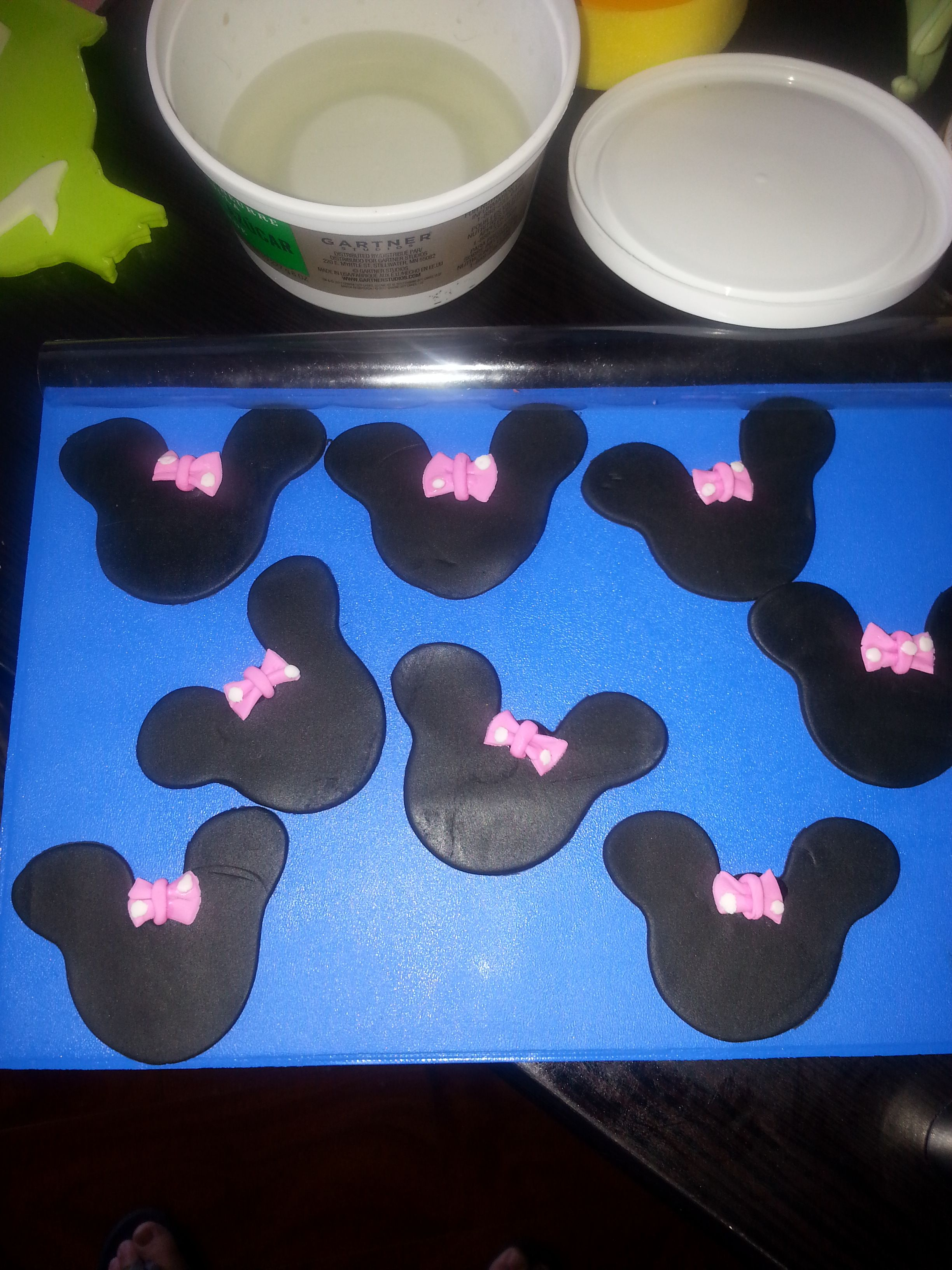 Mini Minnie mouse ears made out of Fondant