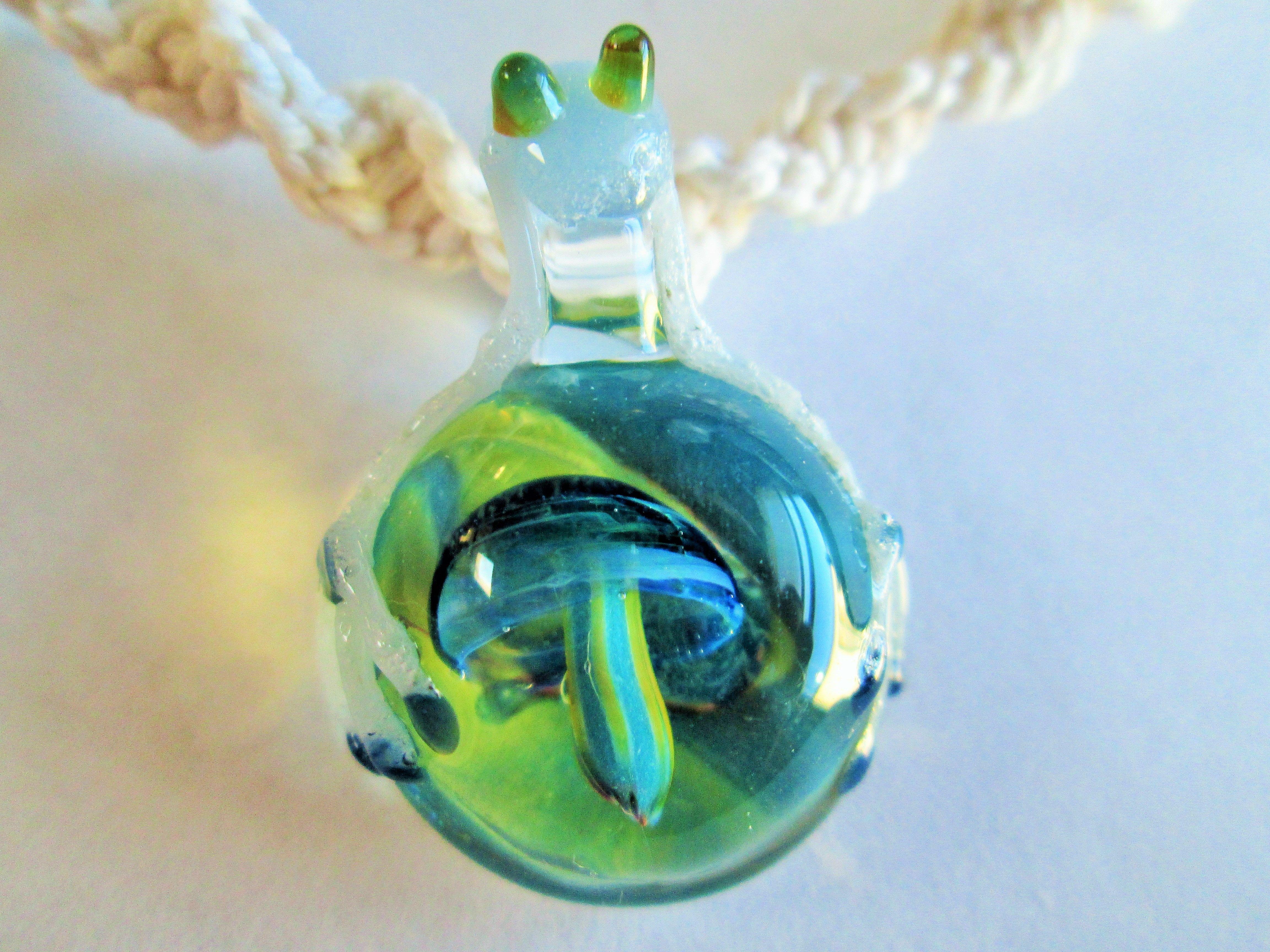 Hand Blown Glass Frog And Mushroom Pendant On Handmade White Hemp