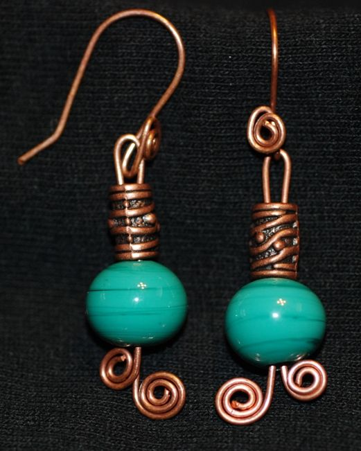 Antique brass wire wrapped earring with brilliant green handcrafted lampwork glass beads.