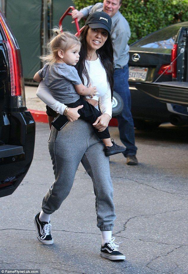 85d3cd419f78e Kourtney Kardashian smiles as she steps out after Scott with a model ...