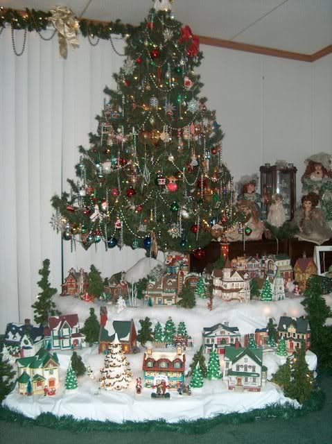 elevate christmas tree and display christmas village below it - Christmas Tree Village