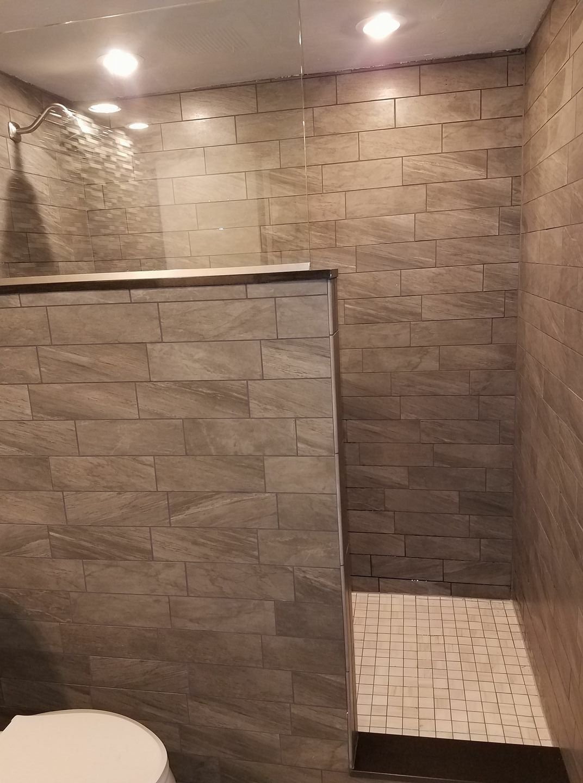 Tiled bathroom remodel. Large walk-in shower. Half wall ...
