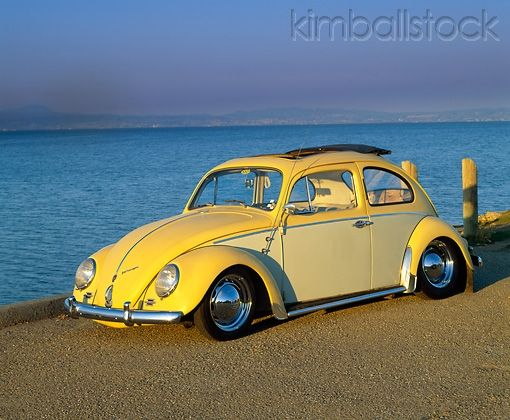 Aut 22 Rk1056 01 1960 Vw Beetle With Sunroof Yellow 3 4 Front View On Pavement By Water Vw Beetles Car Volkswagen Vw Super Beetle