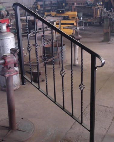 exterior handrails for steps | Iron Railing on Exterior Wrought Iron on wooden railings exterior, stainless steel handrails exterior, deck railings exterior, steel railings exterior, modern railings exterior, iron handrails exterior, doors exterior,
