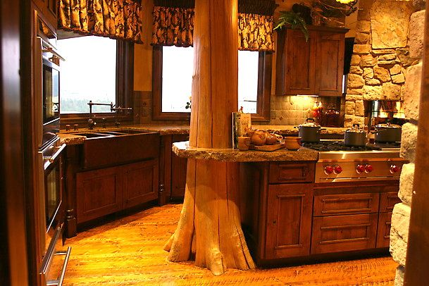 beautiful kitchen idea, having full tree trunks through out the house would be even cooler!