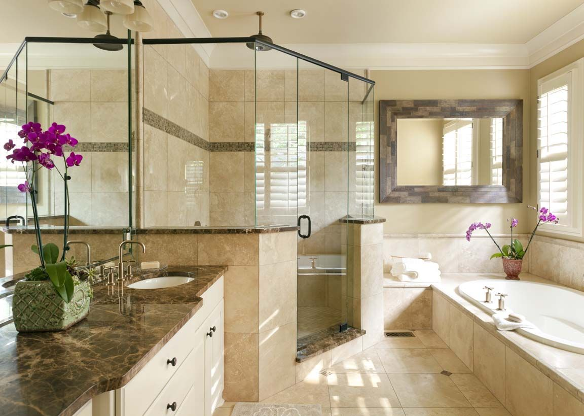 Dark emperador marble countertops contrast with ivory for Travertine tile bathroom gallery