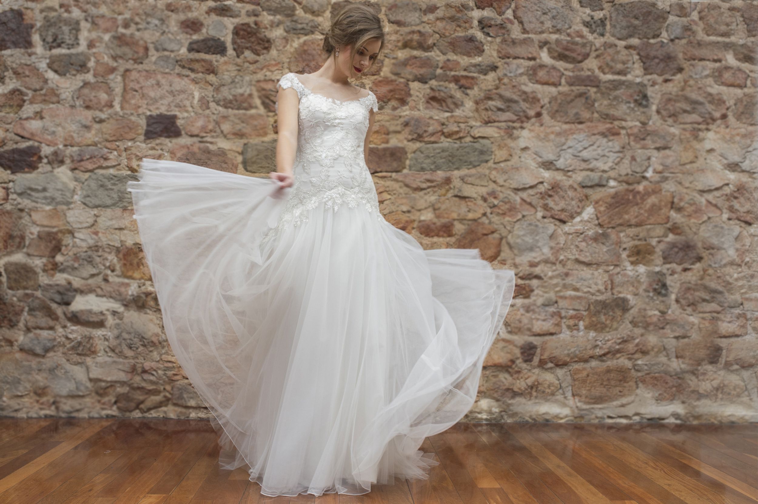 The 'Maggie' gown features the most dazzling and detailed lace you can imagine. The longer line bodice highlights the lace perfectly.   Caleche is located in Adelaide, South Australia.