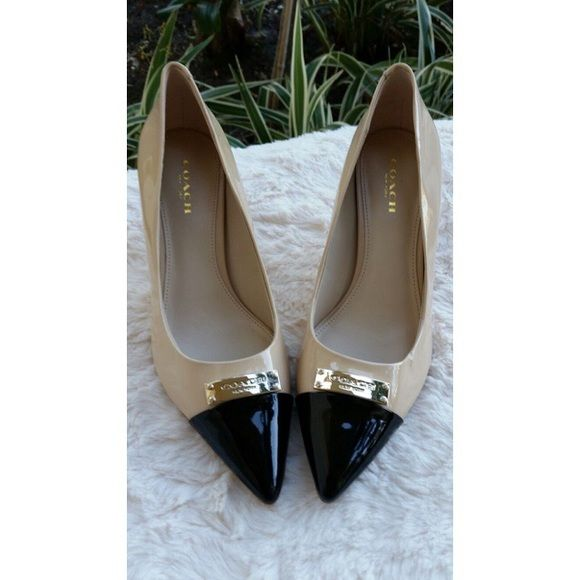 3359772358 Coach Nude Pumps NEW Coach pointed toe nude pumps with black front.  Beautiful gold detailing/emblem. Size 6, heel size: 3.25 in, patent leather.