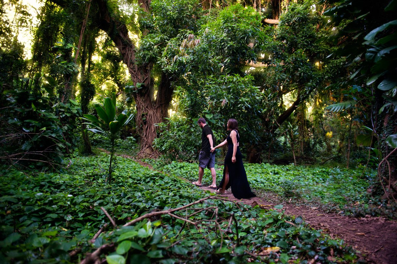 Walking through a jungle in Hawaii. Maui. Oahu. Engagement Photo. Couple photo ideas. Ally Papko Photography & Design. International Wedding Photographer. Boudoir Photographer. Winnipeg www.allypapko.com