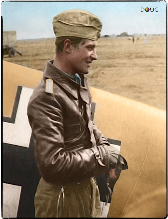 Oblt. Hans-Joachim Marseille, by his Bf109 F-4/Z(Trop) 'Gelb 14' of 3./JG 27 in Libya. c. June 1942.