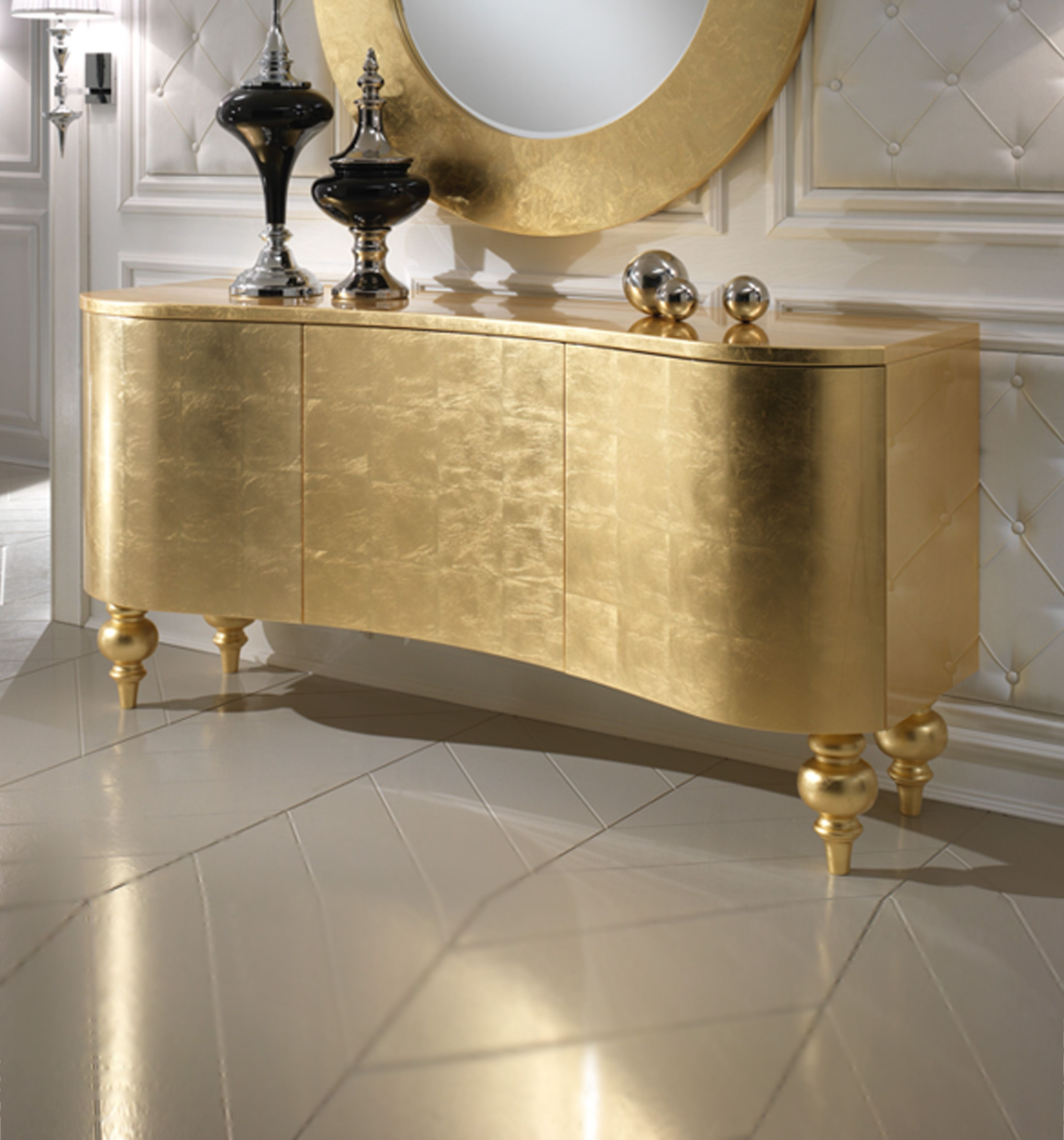 ECCENTRIC SIDEBOARDS An amazing gold sideboard that contrast with the white tom www