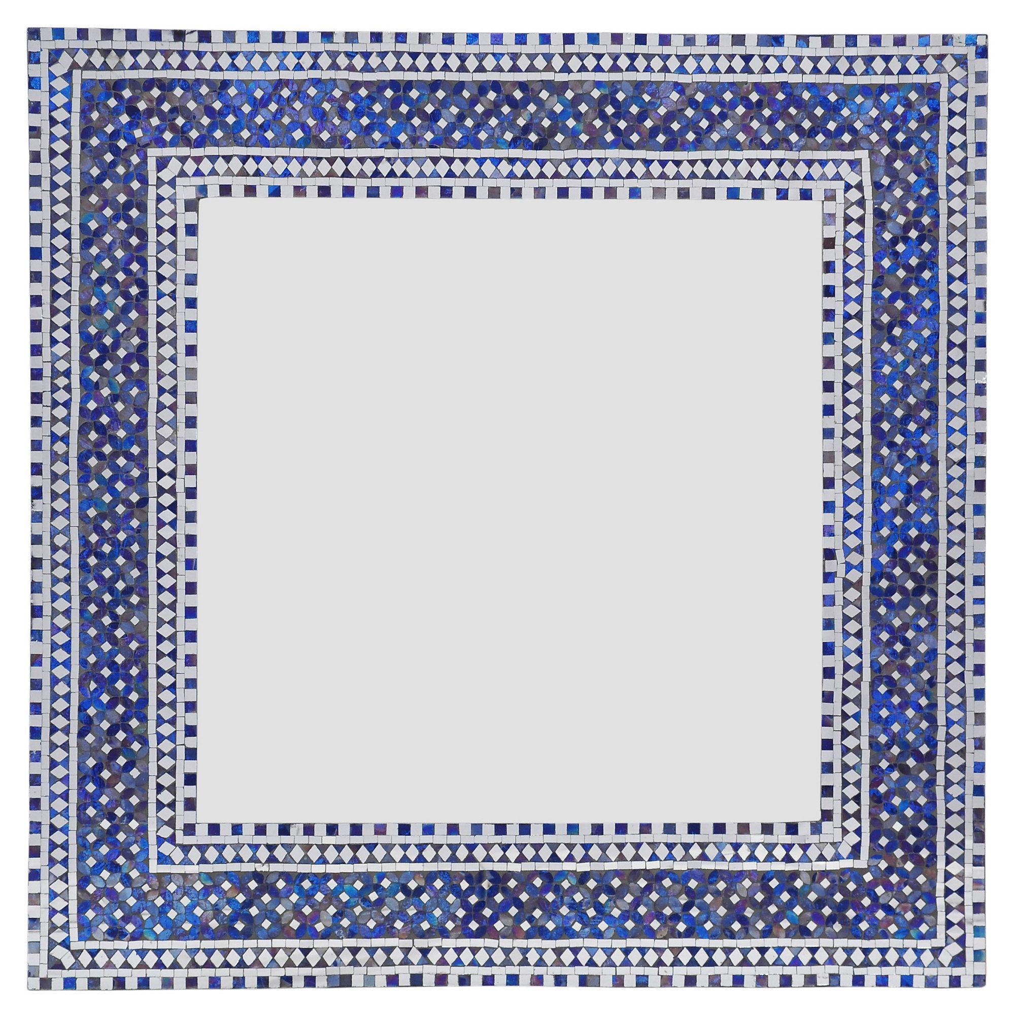 Inspired by palatial mosaic floor designs of Italy and Spain, the printed appearance of this wall mirror is created by beautifully inset pieces of blue and white glass.