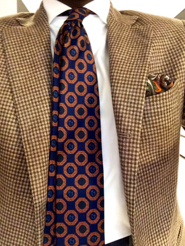 Brown houndstooth tweed blazer, white shirt, brown and navy circle patterned tie, silk P square, casual Friday
