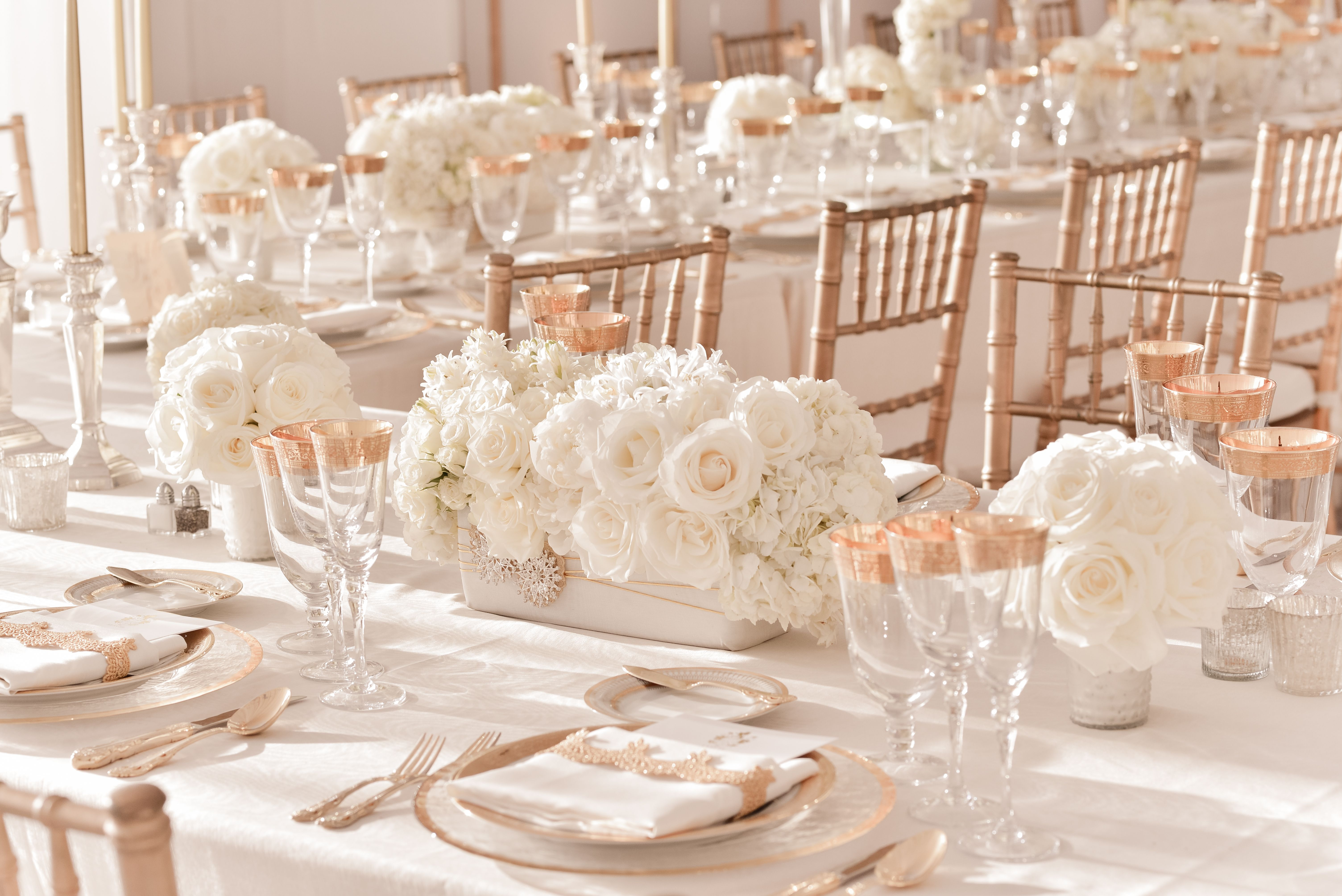elegant ivory wedding centerpieces with rose gold table accents ...