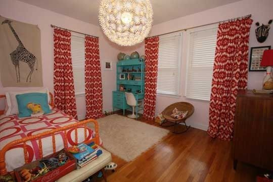 This room i so cute! Love all the colors and especially the giraffe print on the wall
